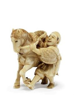 An Ivory Netsuke   Signed Ono Ryoji, Meiji Period (late 19th century)   Of a man struggling with a horse