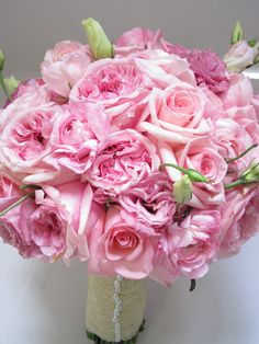 Softs shades of pink made for a beautiful bouquet of pink garden roses, lisianthus and standard roses.