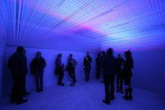 """Jeongmoon Choi, """"How to build a house"""" / 2010 / approx. 20 sqm space, threads, black lights MMX Open Art Venue, Berlin"""