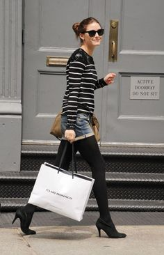 Olivia Palermo after shopping at our Prince Street store. She's the best at a shorts & tights combos! #style #clubmonaco