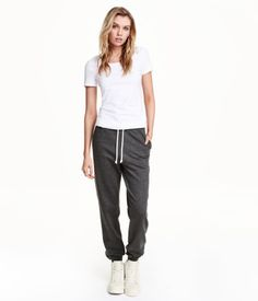 Soft sweatpants with an elasticized drawstring waistband, side pockets, and ribbed hems. Brushed inside.