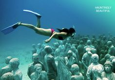 Museo Subacuatico de Arte or the UNDERWATER MUSEUM  in Cancun Mexico.  The artist behind this wonder is Jason deCaires Taylor, an acclaimed eco sculptor.  The amazing thing about these sculptures is that they not only serve as art, but also as a Conservation effort. The sculptures serve as artificial reefs, attracting coral while also drawing divers away from fragile natural reefs.