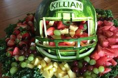 If you're creative in the kitchen, this is the best Super Bowl dessert to show off your skills! You can even carve your favorite player's name into the watermelon helmet! Football Treats, Football Party Foods, Football Cookies, Football Food, Football Parties, Alabama Football, American Football, College Football, Superbowl Desserts