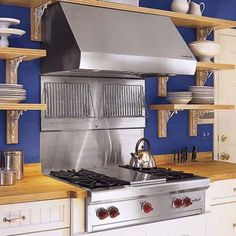 Love the cooktop! Photographs: Ted Morrison | thisoldhouse.com | from 3 Kitchens 3 Budgets
