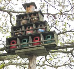 APPALACHIAN FOLK ART BIRD ROOST-Old coffee cans...the bottom ones are plastic Folgers cans...Cool