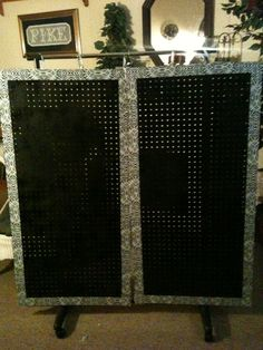 My first display board(for my paparazzi jewelry) using peg board I spray painted black and outlined with zerbra duct tape and hung from clothes rack