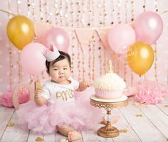 Baby in pink and gold themed baby cake smash photos by Brandie Narola Photography