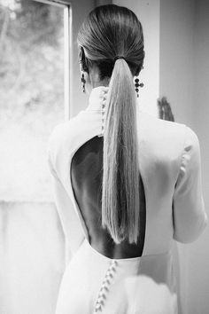 Sensuous high neck, backless, long sleeve wedding dress by Andrea Hawkes. Photography Joanna Bongard. #backlessweddingdress #andreahawkes