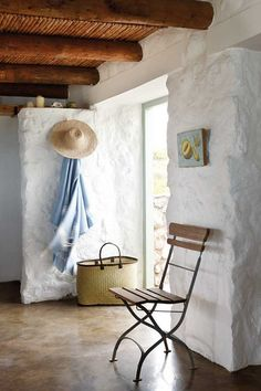 Stone cottage on the West Coast of South Africa, photographer Micky Hoyle via House of Turquoise. Stone/Tile floors, stone/concrete block walls, and exposed beams = rustic but cool in a hot climate.