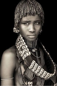 Ethiopia - Omo Black & White Beautiful Photography by John Kenny taken with Africa's remotest tribes. Fine art prints in black and white, also colour, are available to buy in signed, limited editions. Facing Africa: the book is out now John Kenny, Tribes Of The World, People Around The World, Foto Portrait, Portrait Photography, Photography Gallery, Photography Tags, Woman Portrait, Jewelry Photography