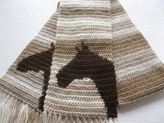 Handmade, brown ombre, crochet, horse head scarf. Scarf is hand crocheted with a multicolored yarn that ranges in color from light cream to cafe brown.