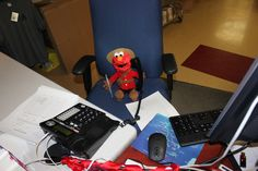 "Elmo taking an order...Elmo ""I will send you one Cookie Monster Plush right away!"""