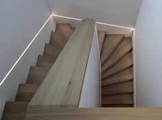 Residence in Lugano is a minimalist house located in Lugano, Switzerland, designed by Volpatohatz. A private client commissioned VOLPATOHATZ to add another level and fully renovate an existing villa f Stairway Lighting, Home Lighting, Lighting Design, Home Stairs Design, Interior Stairs, House Design, Lugano, Small Staircase, Ceiling Light Design