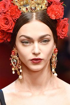 The main idea here is that more is more, with colorful jewels, pearls and metals imbued on earrings, necklaces and rings with a medieval nod.  Pictured: Dolce & Gabbana   - HarpersBAZAAR.com