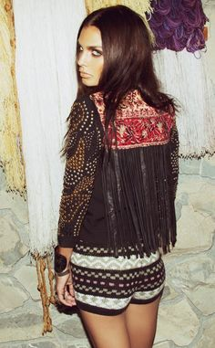 Make a boring jacket into a piece of art. Sew on patches of fabric onto it, stud it and add fringe!