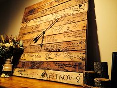 Love my guest book! Pallet wood, clock, sign, guest book
