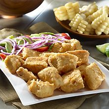 Crunchy Peruvian Fish – Chicharrón de Pescado!  Here, white fish is marinated in a flavorful blend of lemon, garlic and Peruvian yellow hot pepper paste. Then, the fish is coated in flour and dipped in eggs before being fried to crunchy perfection. Enjoy with a squeeze of lime and a fresh salad.