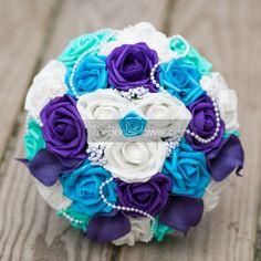 MERMAID Purple, turquoise and aqua blue silk flower wedding bouquet  One of our most popular styles now available in better quality! Perfect mix of royal purple, aqua and turquoise (malibu) blue roses accented with pearls! Beautiful mix to match ocean and mermaid-themed weddings but also works for peacock themes. Made with soft touch roses and surrounded by turquoise (Malibu) blue and aqua (light teal, pool blue) roses and real touch purple calla lilies. Accented with baby's breath and…