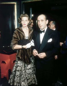 Lauren Bacall and Humphrey Bogart (electing to skip his hairpiece, 1955)