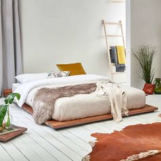 Nice minimalist wood beds at this side - Low Modern Attic Bed Interior Design Minimalist, Minimalist Bedroom, Minimalist Decor, Modern Minimalist, Interior Modern, Minimalist Living, Minimalist Jewelry, Wooden Bed Frames, Wood Beds