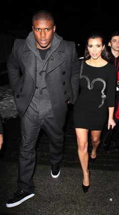 Kim Kardashian and Reggie Bush Photos Photos - Kim Kardashian and boyfriend Reggie Bush leave The Tent in Bryant Park after Kim's involvement at the Heart Truth's Red Dress Collection fashion show during Mercedes-Benz Fashion Week. Kim walked the runway in red dresses created by top designers to raise awareness for women's heart disease. - Kim Kardashian and Reggie Bush Leave The Tent in Bryant Park