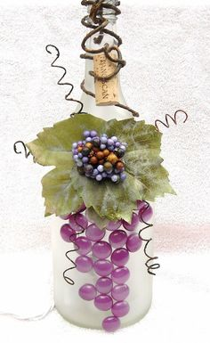 Frosted Wine Bottle Light with Leaves, Purple Berries and Gems. $22.00, via Etsy.