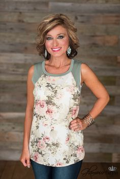 My Favorite Pick with definitely be just that, your favorite pick. Rounded neckline, sleeveless top with contrasting fabric around neckline, sleeves and back, with a beautiful floral fabric on the bodice front.