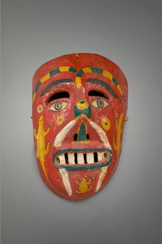 this 'ancestor mask' from folk art of the andes is from peru. with painted reptiles it represents a man from the pre-hispanic ethnic group known as the Wanka or Huanca, known for their fierce battles with the Inca before they were finally subdued.  — at museum of international folk art.