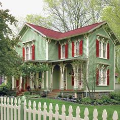 This green house with the red shutters makes for a charming country home. Folk Victorian, Victorian Homes, Victorian Farmhouse, Victorian Cottage, Victorian Interiors, Red Shutters, House Ideas, Old Farm Houses, Home Upgrades