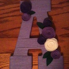 Yarn wrapped letter- flowers