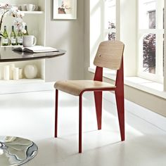 Getting me some of these. Jean Prouve Standard Chair, red.