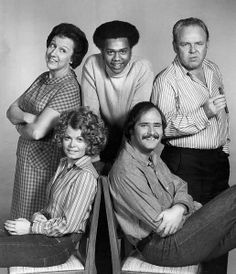 """Cast of the television program """"All In the Family."""" Standing, from left: Jean Stapleton (Edith Bunker), Mike Evans (Lionel Jefferson), Carroll O'Connor (Archie Bunker). Seated: Sally Struthers (Gloria Bunker Stivic) and Rob Reiner (Mike Stivic). Family Tv, All In The Family, Jean Stapleton, Sally Struthers, Carroll O'connor, 70s Sitcoms, Archie Bunker, Mike Evans, Old Shows"""