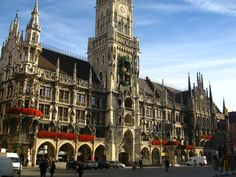 Marienplatz in Munich.  The tower houses the Glockenspiel, a 100+ year old carillon. Every day at 11am and noon, people gather in front of the tower to hear the Glockenspiel chime and watch 32 life-sized figures reenact historical Bavarian events. A golden bird chirps 3 times to mark the end of each show.
