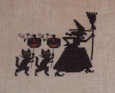 http://www.etsy.com/listing/107857573/completed-cross-stitch-witch-black-cats