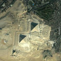 birds eye view of the Giza Pyramids in Egypt Earth And Space, Giza Egypt, Pyramids Of Giza, Great Pyramid Of Giza, Famous Places, Birds Eye View, Aerial Photography, Places Around The World, Ancient Egypt