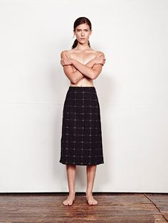 b35ca2e125bd a straight pull-on skirt with an elasticated back waistband and side slits.  falls to the mid-shin. featured here in our custom yarn dye woven black  magic ...