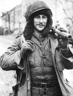 PFC Bill Vegso advances in Germany shortly before the end of the war. Note substantial fur hat, M1A carbine and Browning .30 cal machine gun.
