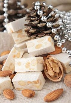 Almond Nougat Candy: This delicious chewy nougat candy is inspired by the amazing flavors of Torrone, an Italian candy traditionally made with honey, almonds and eggs. This version is made with slightly less expensive ingredients, but offers a delectable flavor!