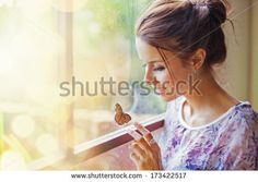 woman touching a butterfly - stock photo