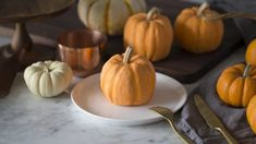 Photo of pumpkin bundt cakes mixed with real pumpkins that look almost identical