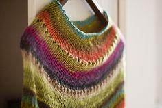 Very nice design. Noro Sekku is the yarn.
