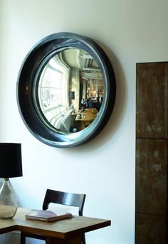 convex mirrors...love this one from Ochre. West Elm has cheaper ones though, which look great alone or in a mini collage of 3 (different sizes)
