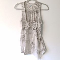 Ruffled Tank Incredible ruffled tank with layers of cotton and chiffon. Wore once on Restaurant Impossible. Flowy front, simple back. Anthropologie Tops Tank Tops