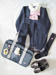 Japanese school uniform - so cute! I would love one of the bags to decorate for my own!