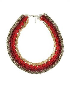 Beni Red Necklace Brooklyn-based Peruvian designer Andrea Bocchio is storming the market with her jewelry collection. Her merger of traditional knitting and crocheting with bold, cool accents set her
