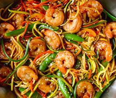 Take on the takeout with a quick and healthy Asian zucchini noodles recipe starring fresh veggies, garlicky sauce and sautéed shrimp.