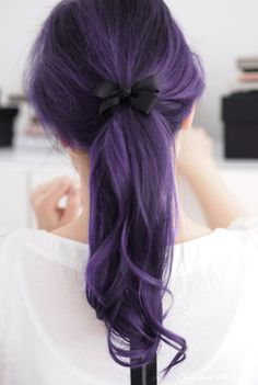 Dark violet purple hair (heavily colored black base) in a ponytail with a cute black bow