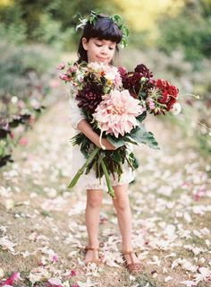 Adorable flower girl with giant dahlias: http://www.stylemepretty.com/2016/04/18/french-chateau-wedding-inspiration-to-sweep-you-off-your-feet/ | Photography: Kayla Barker - http://kaylabarker.com/