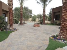 Paver walkway leading to the fire pit in the back courtyard