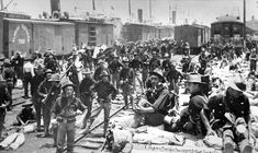 A black and white photo taken in 1898 at Port Tampa of soldiers waiting for trains during the Spanish American War.